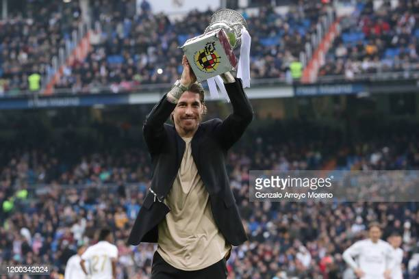 Captain Sergio Ramos of Real Madrid CF offers their Spain Supercup trophy to the fans prior to start the Liga match between Real Madrid CF and...