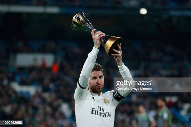 Captain Sergio Ramos of Real Madrid CF offers to the audience the recently won FIFA Club World Cup trophy prior to start the La Liga match between...