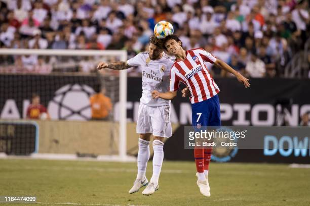 Captain Sergio Ramos of Real Madrid goes up for the header with Joao Felix of Atletico Madrid during the International Champions Cup Friendly match...