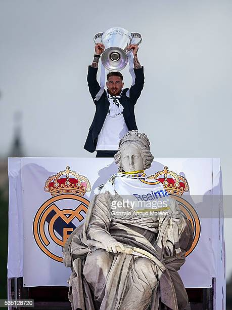 Captain Sergio Ramos of Real Madrid holds the Trophy in celebration behind Cibeles font after winning the Uefa Champions League Final match against...