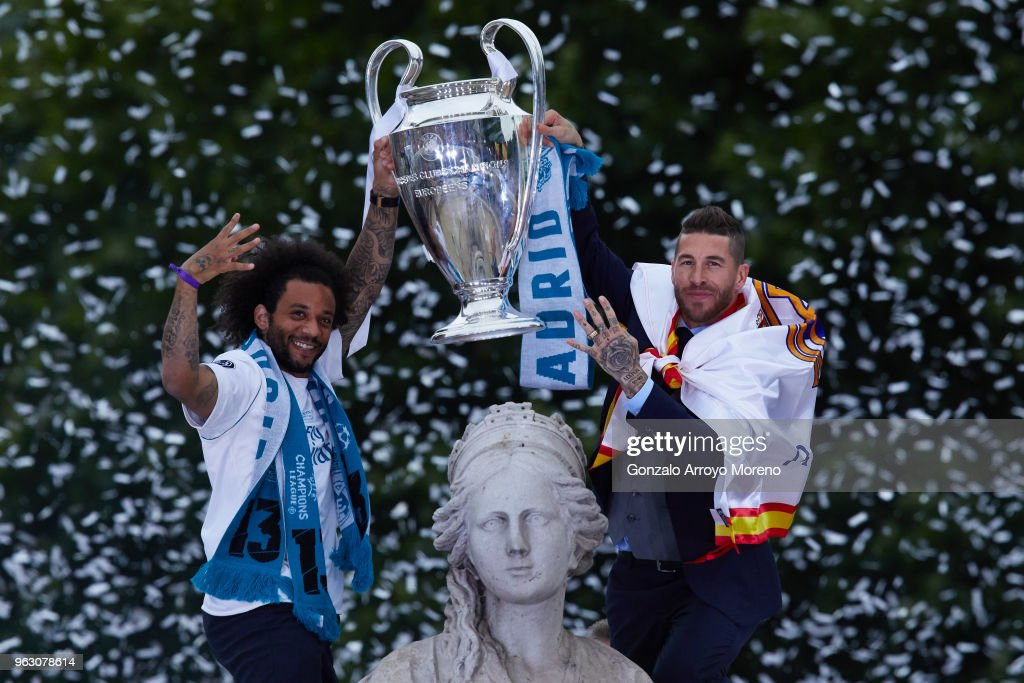 Captain Sergio Ramos (R) of Real Madrid holds up the Champions League trophy with his teammate Marcelo (L)t as they celebrate at Cibeles Square a day after winning their 13th European Cup and UEFA Champions League Final on May 27, 2018 in Madrid, Spain.