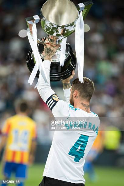 Captain Sergio Ramos of Real Madrid holds up the trophy prior to the La Liga match between Real Madrid and Valencia CF at the Santiago Bernabéu...