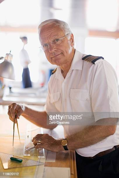 captain setting the compasses - team captain stock pictures, royalty-free photos & images