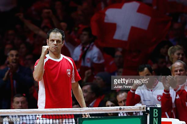 Captain Severin Luthi of Switzerland supports Roger Federer of Switzerland and Stanislas Wawrinka of Switzerland against Richard Gasquet of France...