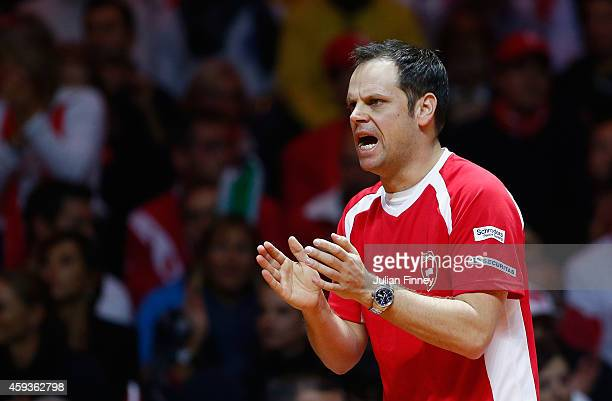 Captain Severin Luthi of Switzerland supports Stanislas Wawrinka of Switzerland in his match against JoWilfried Tsonga of France during day one of...
