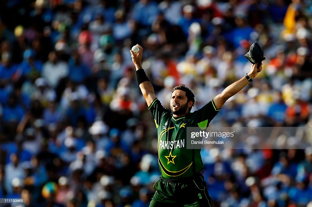Captain Shahid Afridi of Pakistan celebrates after taking the catch to dismiss Sachin Tendulkar of India off the bowling of Saeed Ajmal of Pakistan during the 2011 ICC World Cup second Semi-Final between India and Pakistan at Punjab Cricket Association (PCA) Stadium on March 30, 2011 in Mohali, India.