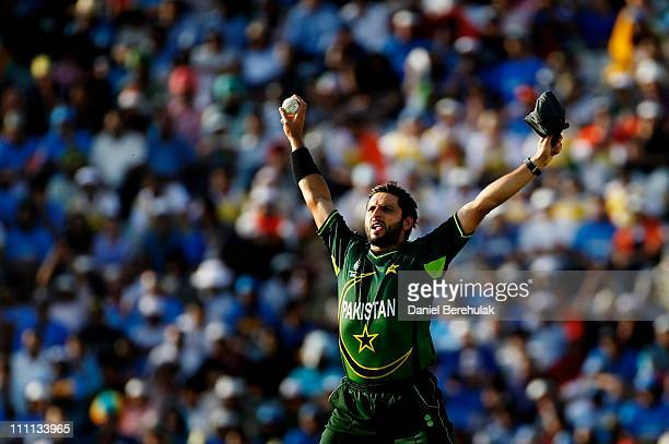 Captain Shahid Afridi of Pakistan celebrates after taking the catch to dismiss Sachin Tendulkar of India off the bowling of Saeed Ajmal of Pakistan...