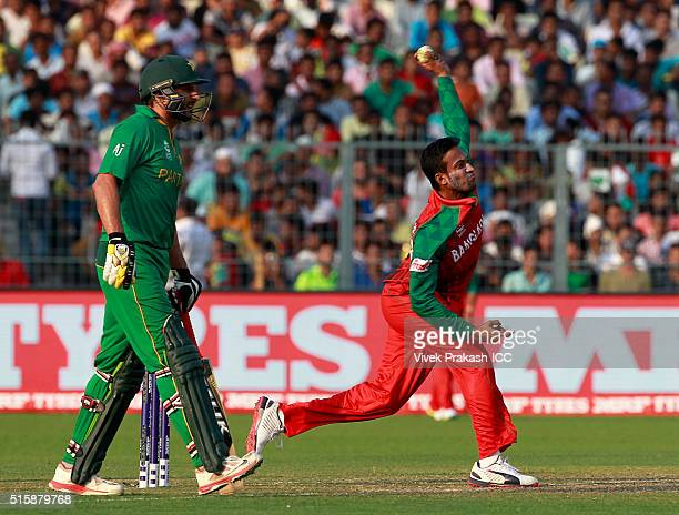 Captain Shahid Afridi of Pakistan watches Shakib Al Hasan of Bangladesh bowl during the ICC World Twenty20 India 2016 match between Pakistan and...