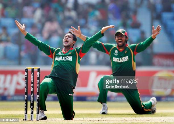 Captain Shakib Al Hasan of Bangladesh and team mate Shahriar Nafees appeal successfully for the wicket of Wesley Barresi of the Netherlands during...
