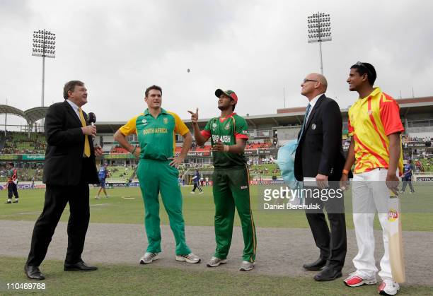 Captain Shakib Al Hasan of Bangladesh takes the toss as captain Graeme Smith of South Africa looks on during the ICC World Cup Cricket Group B match...