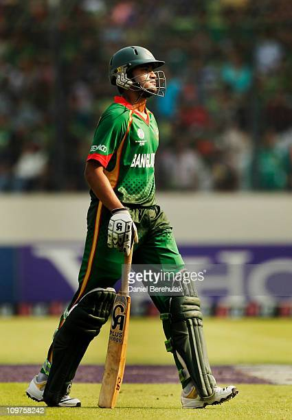 Captain Shakib Al Hasan of Bangladesh walks back to the pavillion after being dismissed during the 2011 ICC World Cup Group B match between...