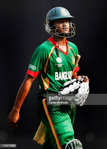 Captain Shakib Al Hasan of Bangladesh walks back to the pavillion after being dismissed by Robin Peterson of South Africa during the ICC World Cup...