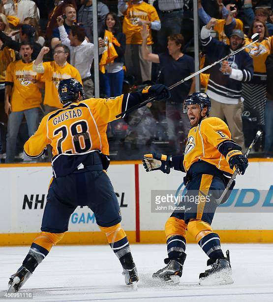Captain Shea Weber of the Nashville Predators celebrates his goal with Paul Gaustad against the Ottawa Senators at Bridgestone Arena on October 9...