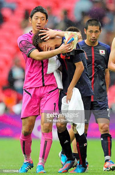 Captain Shuichi Gonda of Japan consoles Takahiro Ohgihara after the Men's Football Semi Final match between Mexico and Japan on Day 11 of the London...
