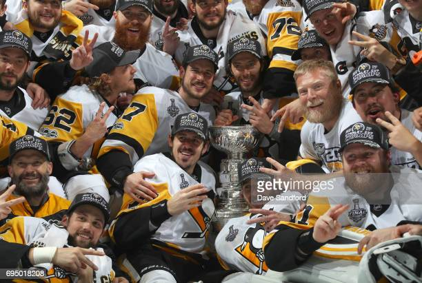 Captain Sidney Crosby Evgeni Malkin Matt Cullen Carl Hagelin Brian Dumoulin and their Pittsburgh Penguins teammates pose for a team photo with the...