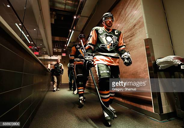 Captain Sidney Crosby of the Pittsburgh Penguins and his teammates make their way to the ice for Game One of the 2016 NHL Stanley Cup Final against...