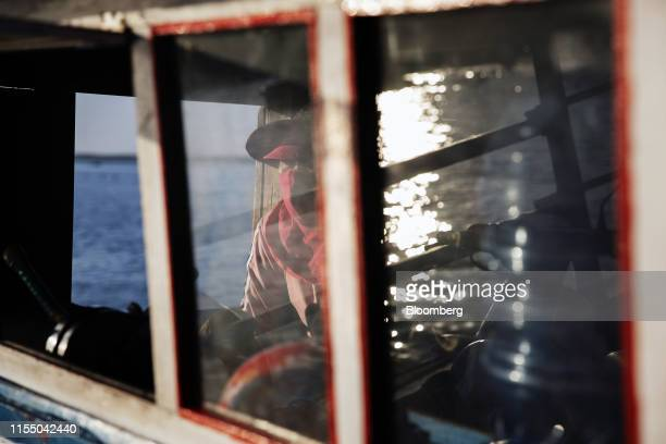 A captain sits in the bridge of a ferry as it travels from Tan Quang harbor to Tan Giang harbor in Quang Nam province Vietnam on Wednesday June 26...