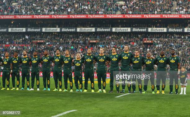 Captain Siya Kolisi of South Africa sings the national anthem alongside team mates prior to the first test between and South Africa and England at...