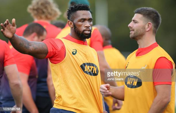 Captain Siya Kolisi of South Africa talks with team mate Willie le Roux during a South Africa Springboks Training Session at Churchie Grammar School...