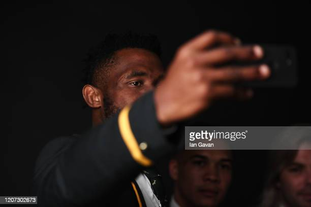 Captain Siya Kolisi of the South African Rugby Union team winners of the Laureus World Team of the Year takes a selfie during the 2020 Laureus World...