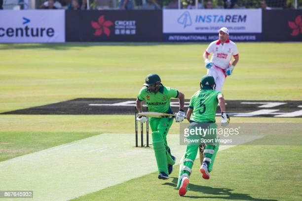 Captain Sohail Tanvir and Anwar Ali of Pakistan run between the wickets during Day 1 of Hong Kong Cricket World Sixes 2017 Group A match between...