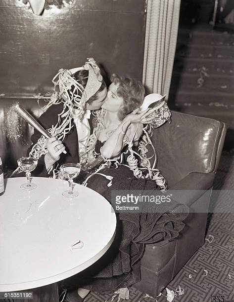 Captain Sol Gerson and his companion Miss Gertrude Holtorf share a kiss to welcome in the New Year at the Rainbow Room in New York City