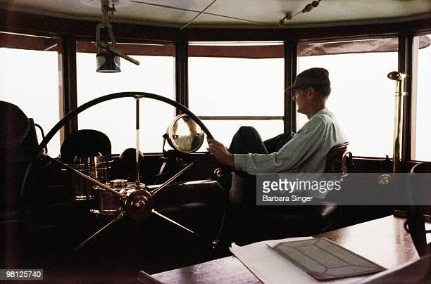 Captain steering boat