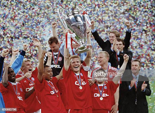 Captain Stefan Effenberg of Bayern Munich lifts the Cup as the team celebrate at the conclusion of the UEFA Champions League Final between Bayern...