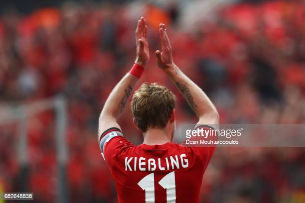 Captain Stefan Kiessling of Bayer 04 Leverkusen celebrates in front of the home fans after the Bundesliga match between Bayer 04 Leverkusen and 1 FC...