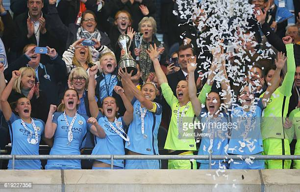 Captain Steph Houghton lifts the trophy after her side won the Women's Super Leauge1 during Women's Super League1 match between Manchester City and...