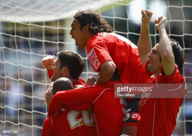 Captain Stephen Foster of Barnsley celebrates with Anderson De Silva and Jamal CampbellRyce after Jamal CampbellRyce scored the winning goal for...