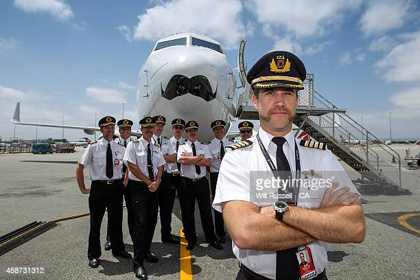 Captain Stephen Paul and Qantas pilots pose with the Qantas Mo Plane at Perth Airport on November 10 2014 in Perth Australia