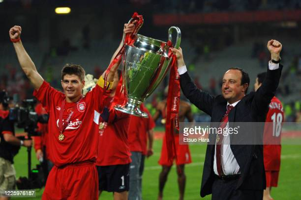 Captain Steven Gerrard and manager Rafael Benitez of Liverpool lift the trophy after the ceremony following the UEFA Champions League final between...