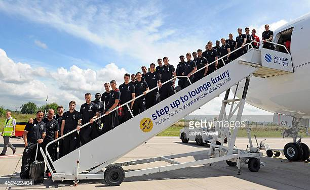Captain Steven Gerrard of Liverpool and CEO of Liverpool Football Club Ian Ayre pose with the rest of the Liverpool FC team before boarding the plane...