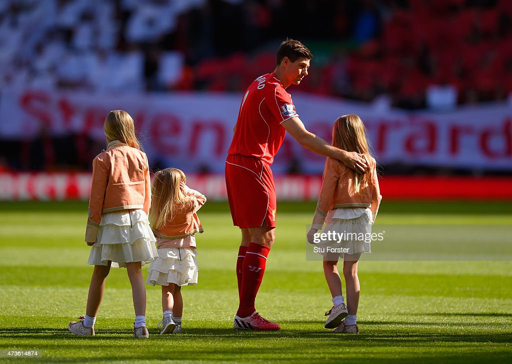Captain Steven Gerrard of Liverpool walks onto the pitch with his daughters Lilly-Ella, Lourdes and Lexie during the Barclays Premier League match between Liverpool and Crystal Palace at Anfield on May 16, 2015 in Liverpool, England.