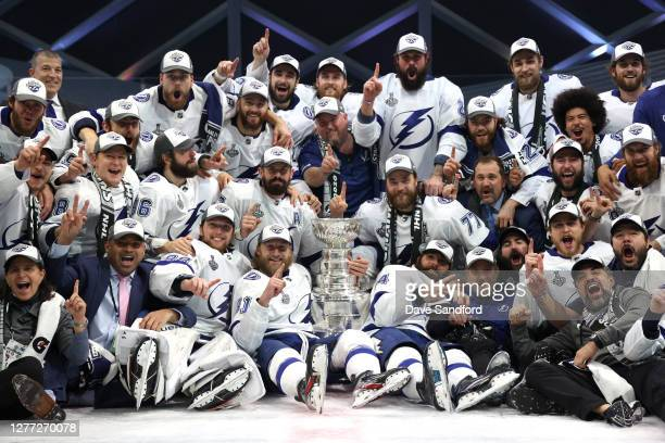Captain Steven Stamkos and his Tampa Bay Lightning teammates pose on the ice with the Stanley Cup after the Tampa Bay Lightning defeated the Dallas...
