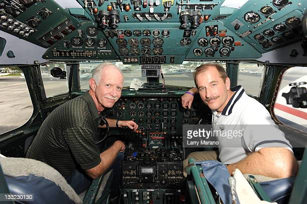 Captain Sully Sullenberger and Copilot Jeff Skiles pose in the cockpit of the Historical 1958 DC7 to benefit hosted by Historical Flight Foundation...