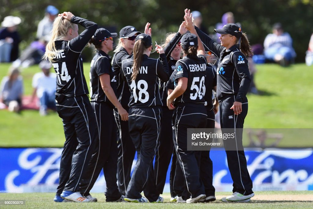 Captain Suzie Bates of New Zealand (R) and her team mates celebrate after Kycia Knight of the West Indies is run out during the Women's One Day International match between New Zealand and the West Indies on March 11, 2018 in Christchurch, New Zealand.