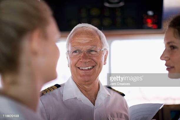 captain talking to mates - team captain stock pictures, royalty-free photos & images
