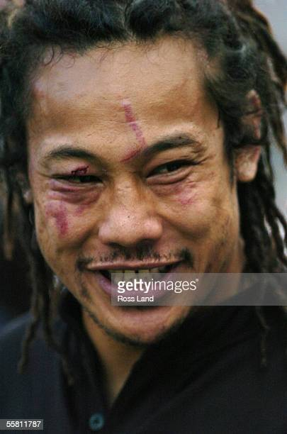 8 captain Tana Umags' face shows the scars a hard battle following the All Blacks 2840 loss to South Africa in the TriNations rugby test played at...