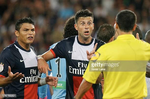 Captain Thiago Silva and Thiago Motta of Paris SaintGermain reacts of the referre during the French League 1 between Paris SaintGermain FC and AC...