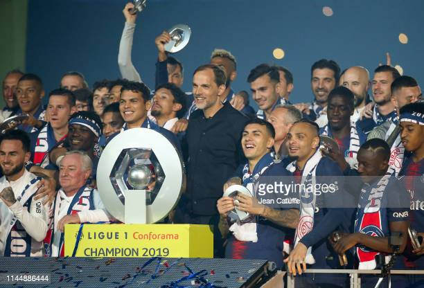 Captain Thiago Silva, coach Thomas Tuchel and players of PSG celebrate winning the 'French Championship 2019' during the trophy ceremony following...