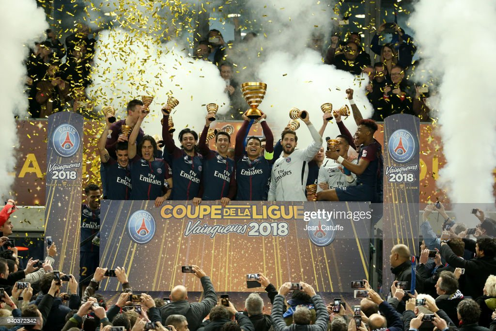 Captain Thiago Silva holding the trophy and teammates of PSG celebrate the victory following the French League Cup (Coupe de la Ligue) final between Paris Saint-Germain (PSG) and AS Monaco on March 31, 2018 in Bordeaux, France.