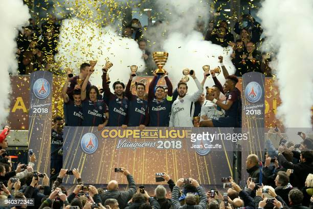 Captain Thiago Silva holding the trophy and teammates of PSG celebrate the victory following the French League Cup final between Paris SaintGermain...