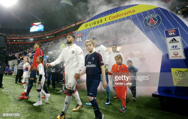Captain Thiago Silva of Paris SaintGermain and Captain Nabil Fekir Olympique Lyonnais entry on the pitch during the Ligue 1 match between Olympique...