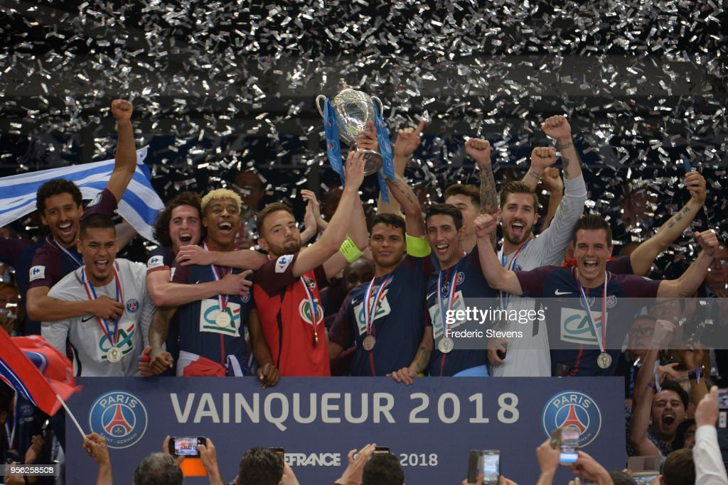 Captain Thiago Silva (R hold the cup) of Paris Saint-Germain and Sebastien Flochon (L hold the cup) captain of Les Herbiers celebrates the victory with teammates during the Coupe de France Final between Les Herbiers VF and Paris Saint-Germain at Stade de France on May 8, 2018 in Paris, France.