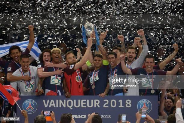 Captain Thiago Silva of Paris Saint-Germain and Sebastien Flochon captain of Les Herbiers celebrates the victory with teammates during the Coupe de...