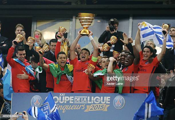 Captain Thiago Silva of Paris SaintGermain celebrates the victory with team mates after the French League Cup Final between Paris SaintGermain FC and...