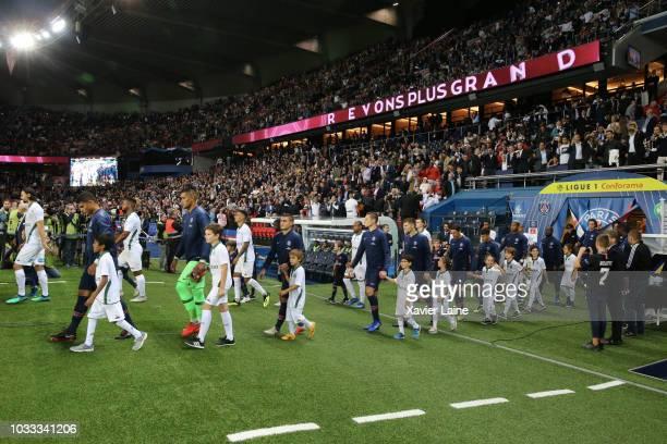Captain Thiago Silva of Paris SaintGermain enter the field with teammattes before the French Ligue 1 match between Paris Saint Germain and AS Saint...