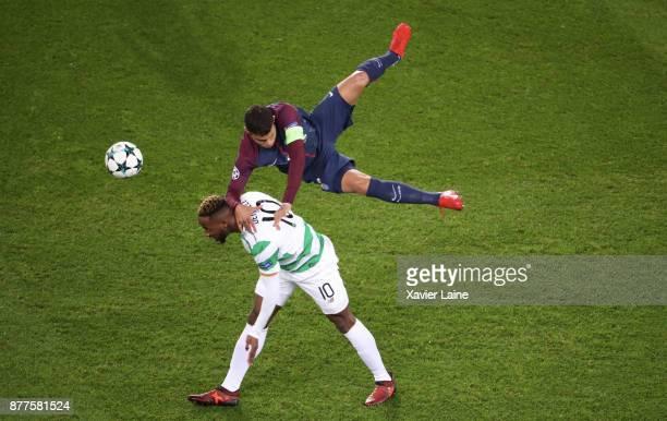 Captain Thiago Silva of Paris SaintGermain jump over Moussa Dembele of Celtics Glasgow during the UEFA Champions League group B match between Paris...